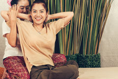 Young Girl get Thai style massage by Woman for body therapy Royalty Free Stock Photography