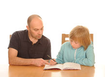 Father helping daughter with homework Stock Images