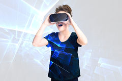 Young girl getting experience using VR headset glasses, is  augmented reality eyeglasses, being in a virtual actuality Stock Images