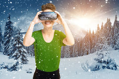 Young girl getting experience VR headset glasses, is using augmented reality eyeglasses, being in virtual actuality, on the hillsi Royalty Free Stock Images