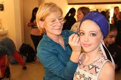 Young ballet Dancer backstage with her teacher. Young girl getting ready backstage before a ballet recital Royalty Free Stock Images
