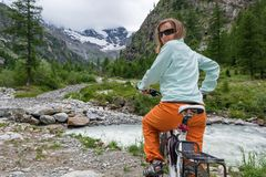 Young girl getting ready to cycle Royalty Free Stock Photo