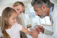 Young girl getting vaccinated at doctor's Royalty Free Stock Image