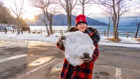 Young girl with giant snowball royalty free stock photos