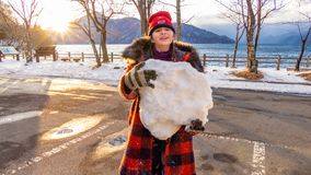 Young girl with giant snowball royalty free stock images