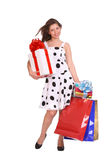 Young girl with gift bag and gift box. Royalty Free Stock Photos