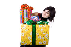 The young girl with a gift box. The young beautiful girl with a gift box on a white background Stock Photography