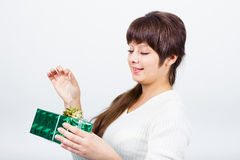 Young girl with a gift box Stock Images