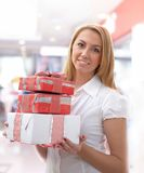 Young girl with gift boxes Royalty Free Stock Images