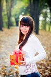 Young girl with gift boxes Stock Images