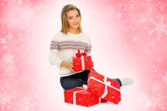 Young girl with gift boxes on winter background Royalty Free Stock Photography