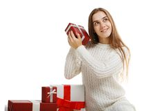 Young girl with gifts isolated on white background. stock photos