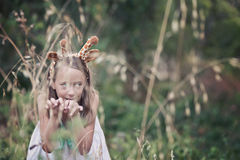 Young girl with giraffe ears, stalking. Just another day on the farm, fancy dress is optional Stock Photos