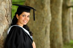 Young girl girl in a graduation gown. royalty free stock photo