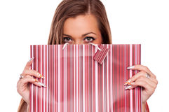 Young girl girl sticking out shopping bags Stock Images