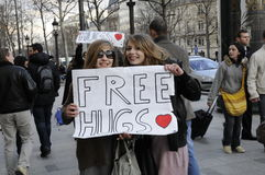 Young girl give free hugs in Champs Elysees street. Beautiful girl give free hugs in paris Champs Elysees street royalty free stock photo
