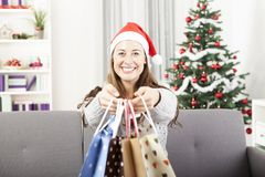 Young girl is give somebody presents bags Stock Image