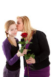 Young girl gives rose to mother Royalty Free Stock Images