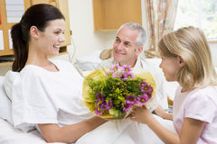 Free Young Girl Giving Flowers To Mother In Hospital Royalty Free Stock Images - 6426709