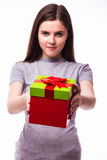Young girl giving a present. Royalty Free Stock Photo