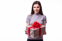 Young girl giving a present. Isolated over white background Royalty Free Stock Images