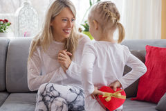 Young girl is giving present to her mother Royalty Free Stock Photography