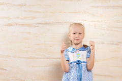 Young girl giving thumbs up Royalty Free Stock Photography