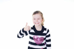 Young girl giving a thumbs up sign Royalty Free Stock Photos