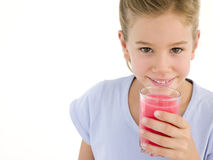 Young girl with glass of juice Stock Photography