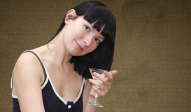 Young girl with glass of martini cocktail Stock Image