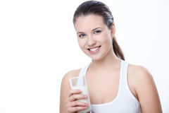 Young girl with a glass of milk Royalty Free Stock Photography