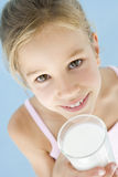 Young girl with glass of milk smiling Stock Photo