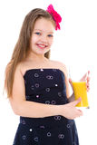 Young girl with glass of orange juice. Stock Image