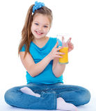 Young girl with glass of orange juice. Royalty Free Stock Photos