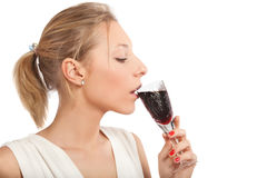 Young girl with   glass of red wine Royalty Free Stock Photography