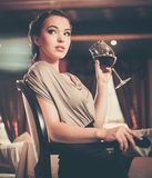 Young girl with glass of red wine Royalty Free Stock Images