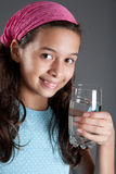 Young girl with a glass of water Royalty Free Stock Photos