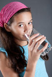Young girl with a glass of water Stock Photo
