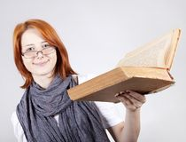 Young girl in glasses with age book. Royalty Free Stock Photo