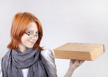 Young girl in glasses with age book. Stock Photos