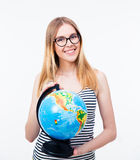 Young girl in glasses holding world globe Royalty Free Stock Image
