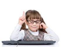 Young girl with glasses and keyboard showing finger up. isolated Royalty Free Stock Images