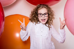 Young girl in glasses showing two fingers victory Royalty Free Stock Photo