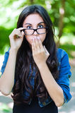 Young girl glasses surprised Stock Image