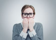 Young girl with glasses is very afraid. Deep fear concept emotion Stock Photography