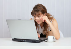 Young girl with glasses working in Internet Stock Photo