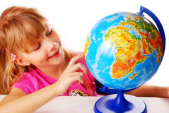 Young girl with globe Royalty Free Stock Photography