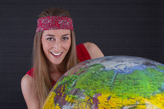Young girl with globe Royalty Free Stock Photos