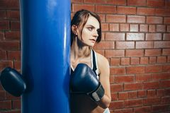 Young girl in gloves resting after a workout in the boxing gym stock photos