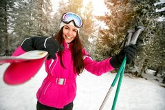 Girl go to skiing on skis on snow in snowy mountains. Young girl go to skiing on skis on snow in snowy mountains Stock Photo